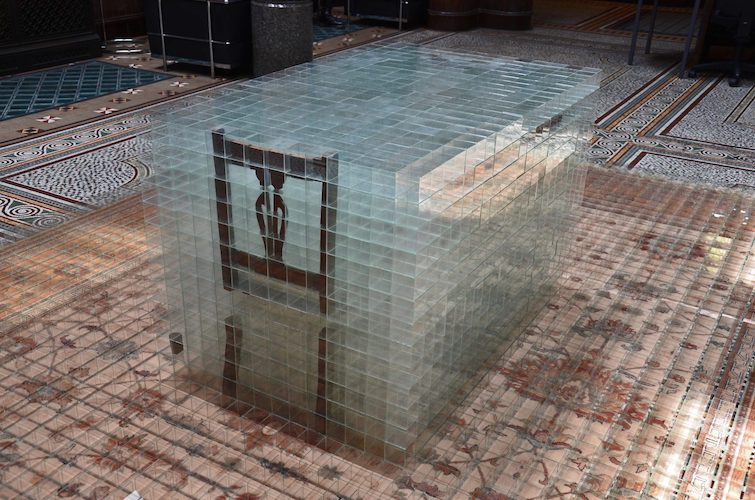 image: David Cheeseman 'Once ever After: Twice Removed' 383×290×81(h)cm, 2014, glass, tape, carpet and furniture (7,752 glass boxes, each 58mm cubed) installed at Birmingham City University, Margaret Street in 2014