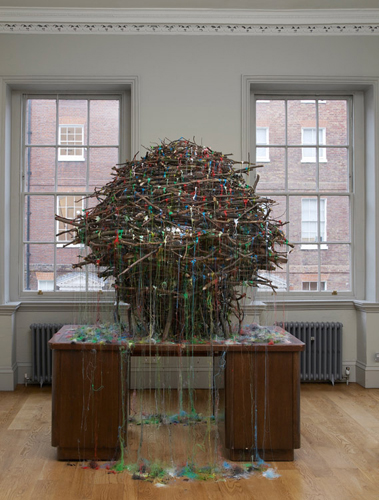 Mhairi Vari 'Hub (John Street)' (Gazing Ball, hot–melt glue, desk, twigs 250(h)×180×180cm 2011) photo by Andy Keate