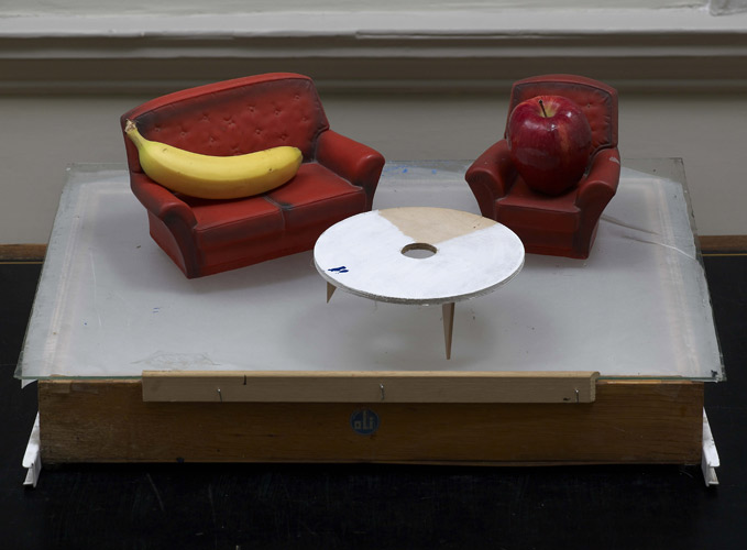 Walter Swennen 'MMX (apple & banana)' (75×60×30cm approx/30×24×12in) found drawer, glass sheet, model plastic 2–piece suite, 1 apple, 1 banana, 2010; photo by Andy Keate.